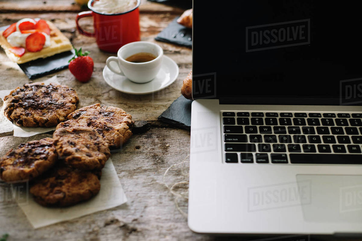 Croissant, coffee, cake, cream, raw strawberry and notebook Royalty-free stock photo