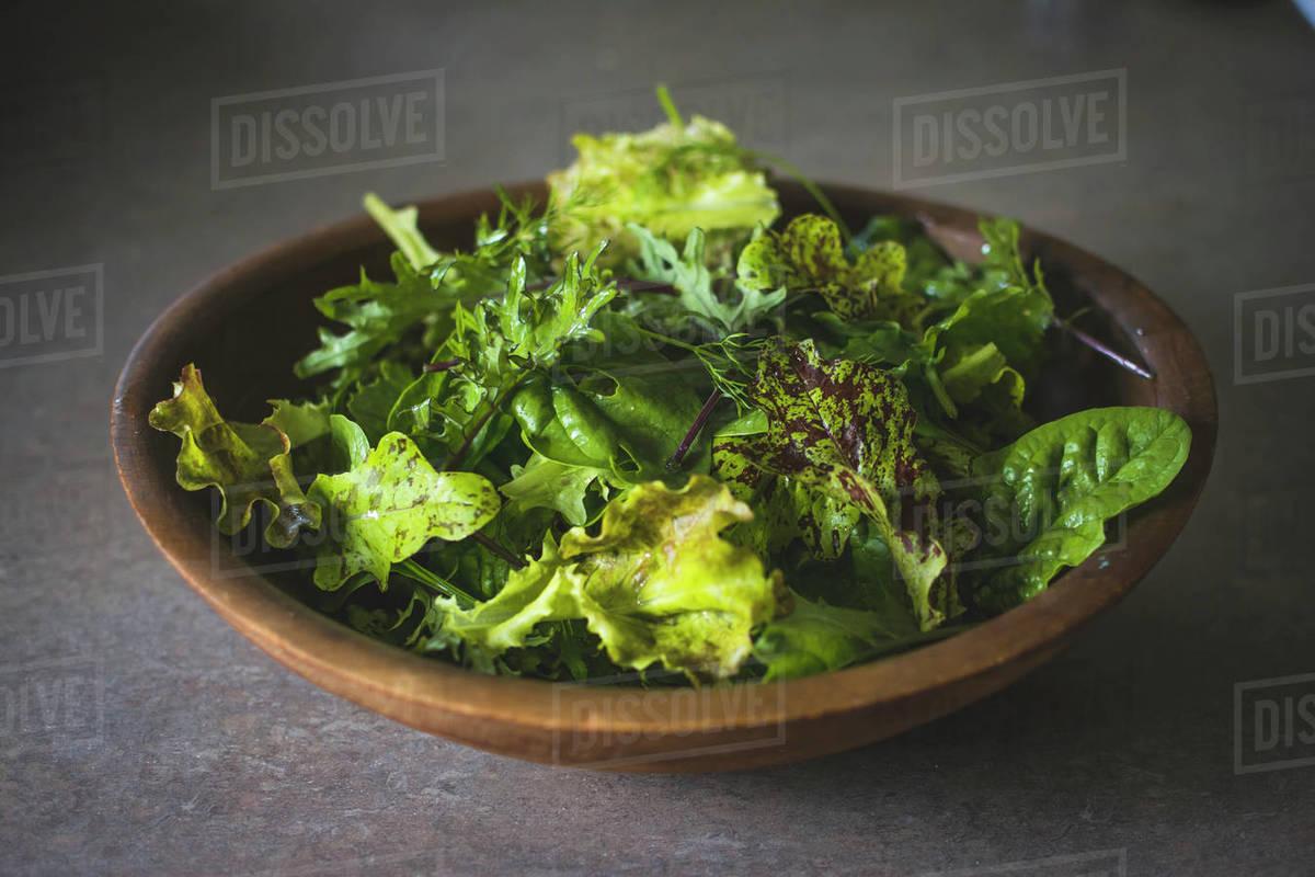 Organic Mixed Greens Salad in a Wooden Bowl Royalty-free stock photo