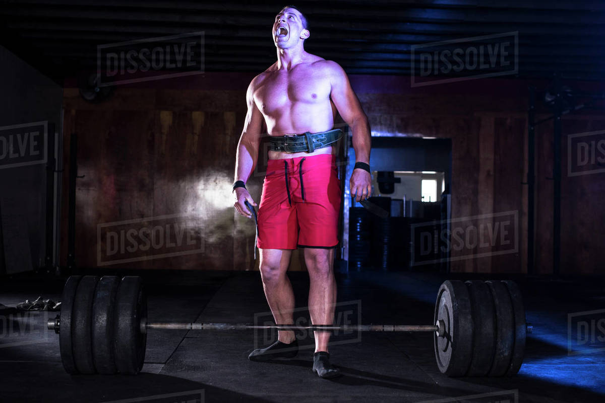 An athlete yells after a heavy deadlift at a gym in San Diego. Royalty-free stock photo