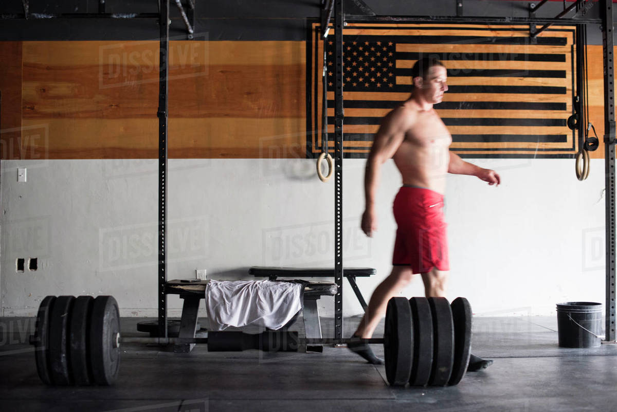 A weightlifter walks away from the barbell after deadlifts Royalty-free stock photo