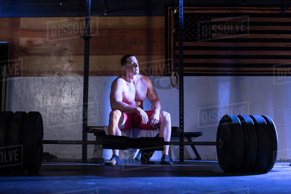 An athlete takes a break before deadlifting. Royalty-free stock photo
