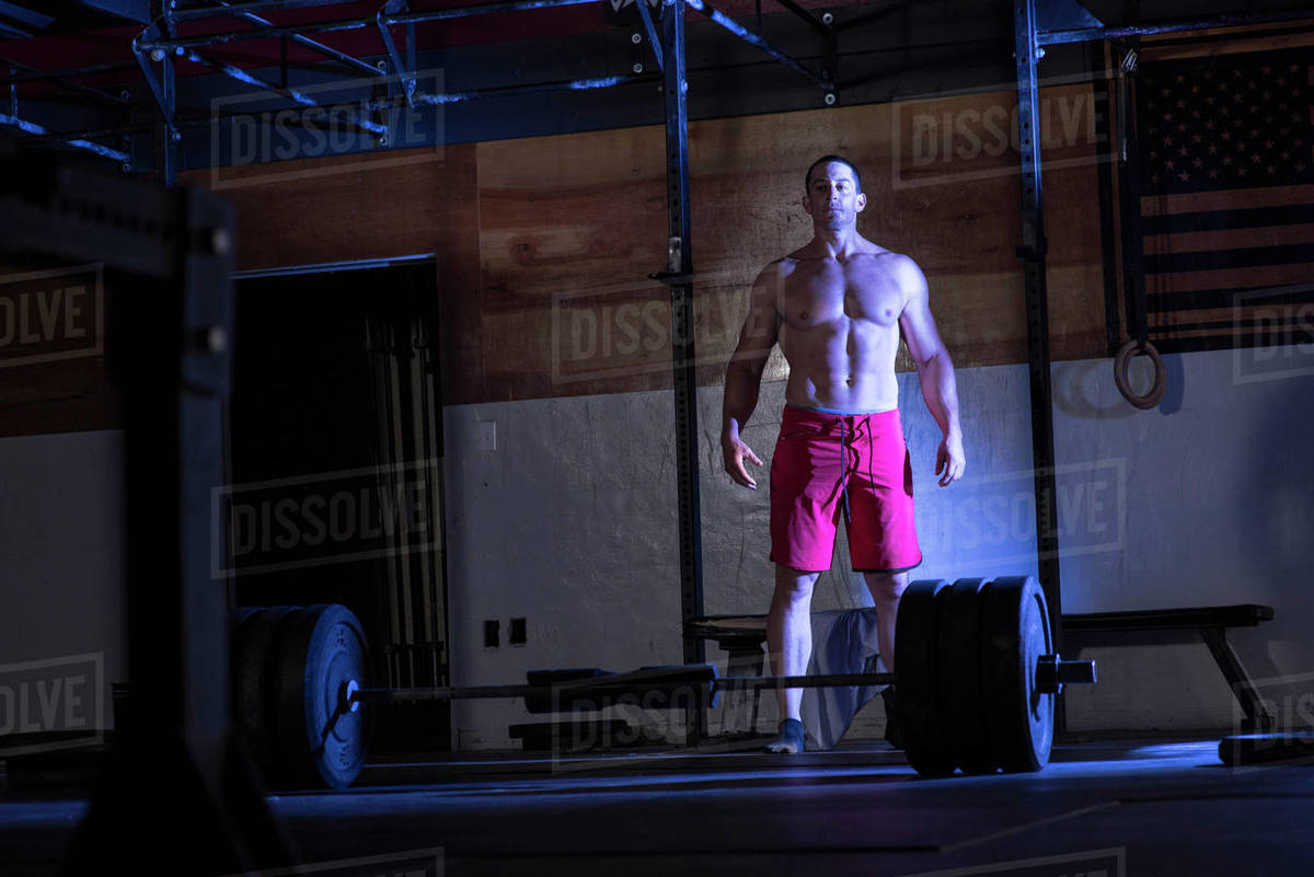 An athlete prepares to deadlift at a warehouse gym in San Diego, CA. Royalty-free stock photo