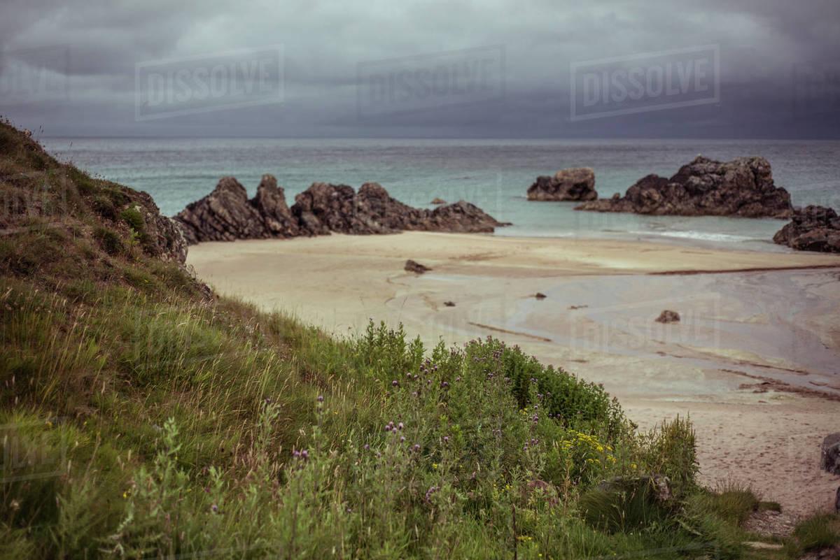 Beautiful empty pristine beach with moody sky in remote scotland Royalty-free stock photo