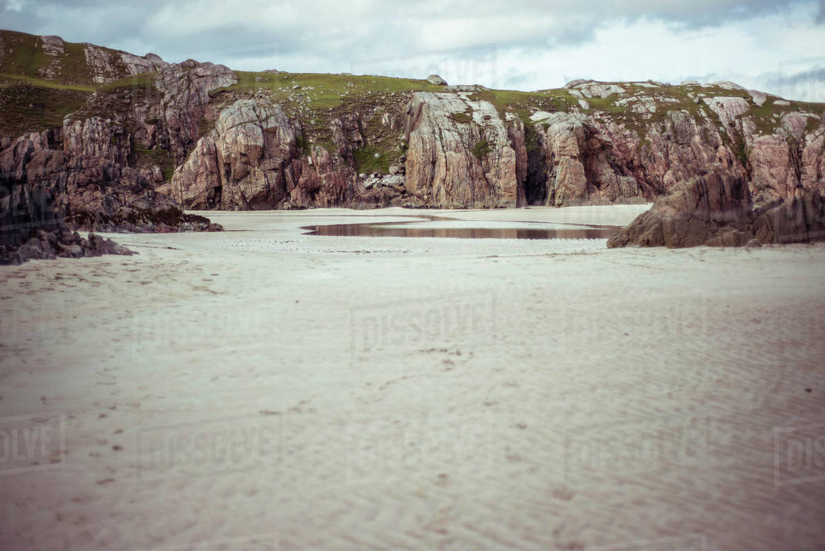 Tide rises on rocky beach Royalty-free stock photo