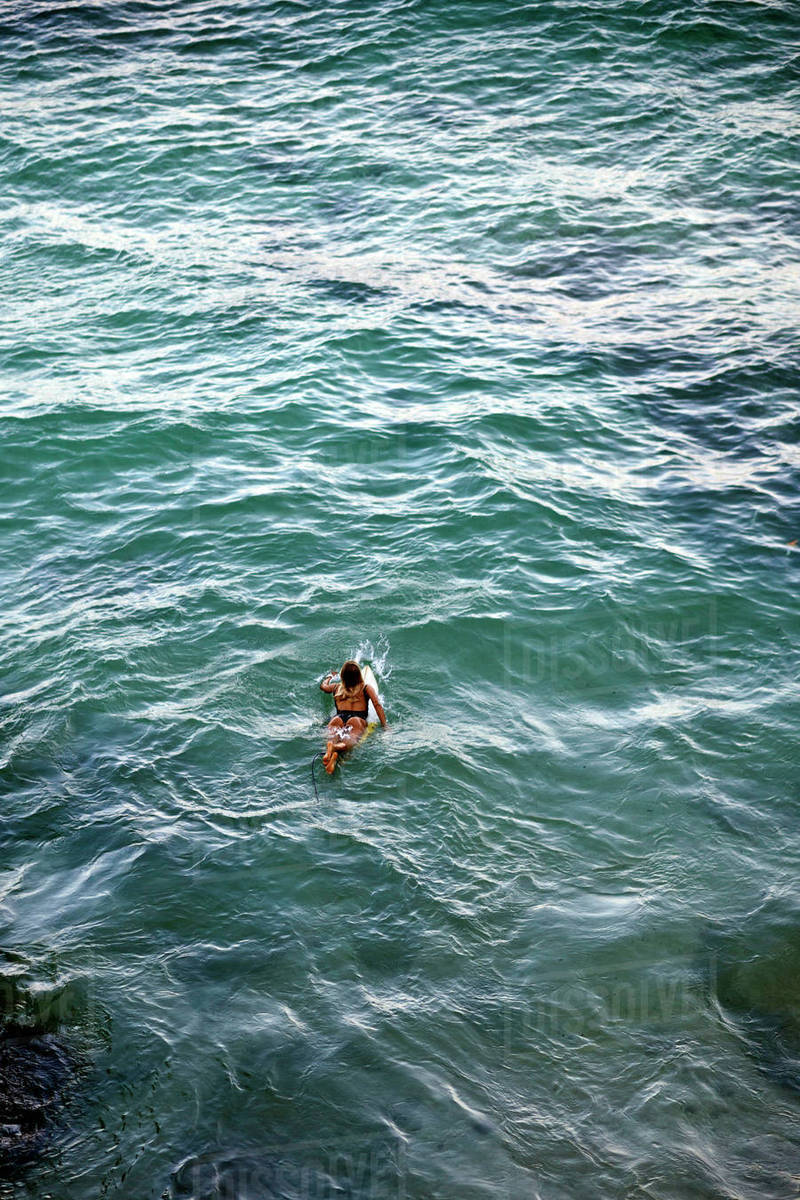 High angle view of woman surfing in sea Royalty-free stock photo