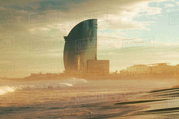 W Barcelona hotel by beach against sky at sunset Royalty-free stock photo