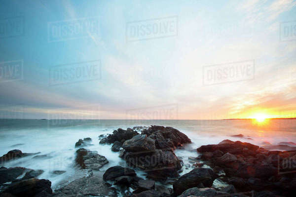 Scenic view of rocky shore during sunset Royalty-free stock photo