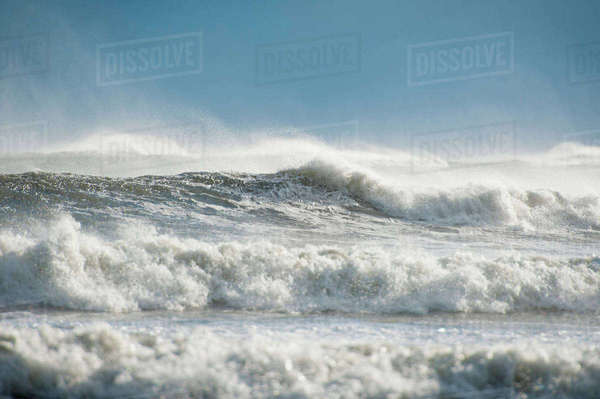 Waves on shore at beach against sky Royalty-free stock photo