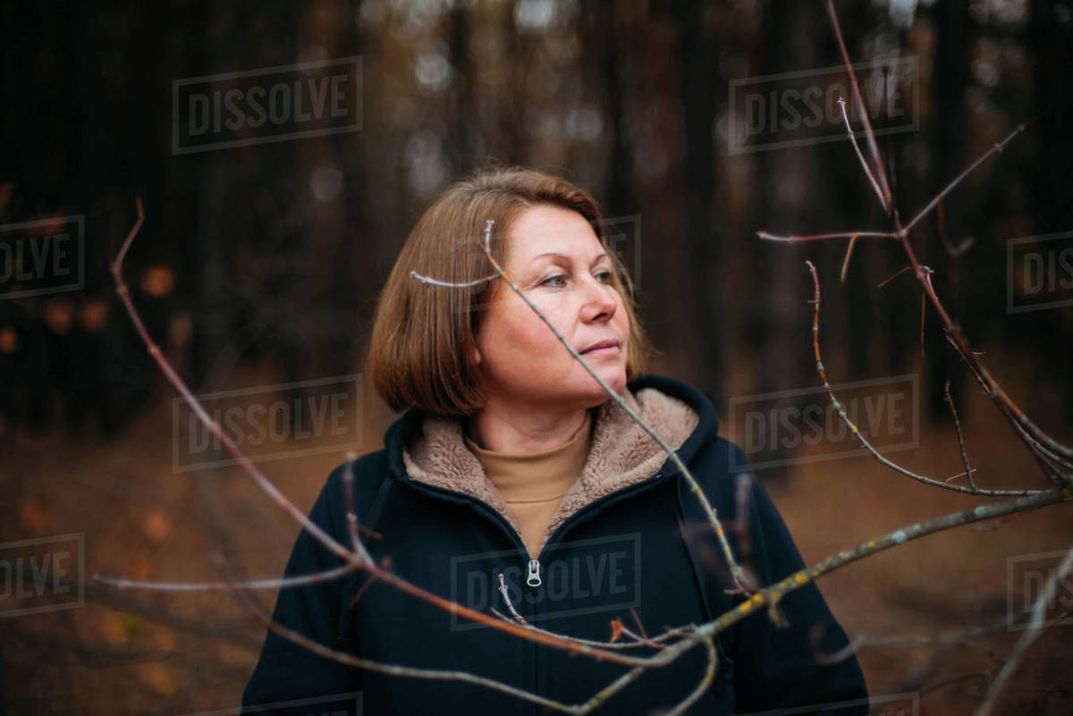Close-up portrait of woman standing in forest Royalty-free stock photo