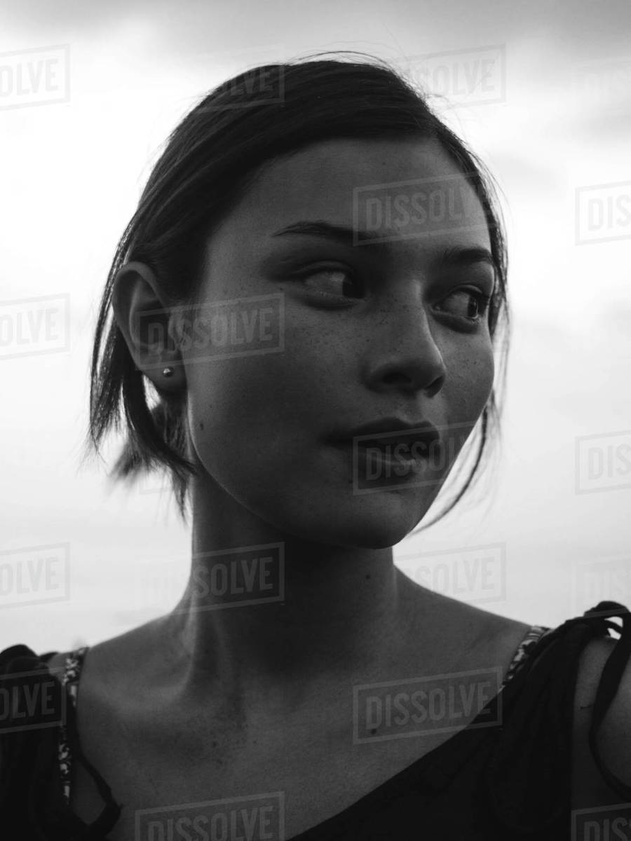 Close-up candid portrait of pretty asian looking away in b&w Royalty-free stock photo