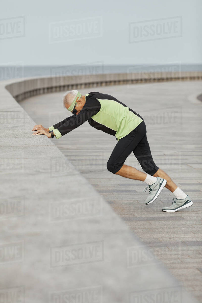 Man Wearing Sporty Outfit Exercising At Seafront Royalty-free stock photo