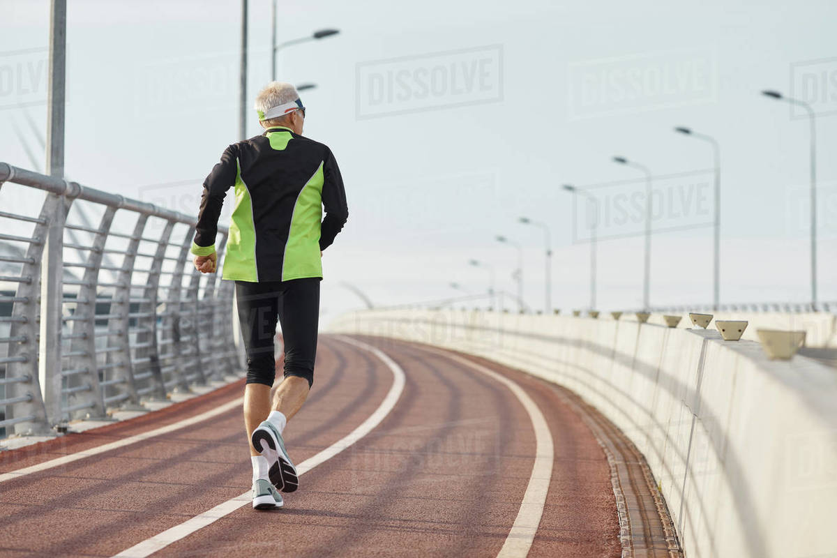 Unrecognizable Elderly Man Running Along Track Royalty-free stock photo