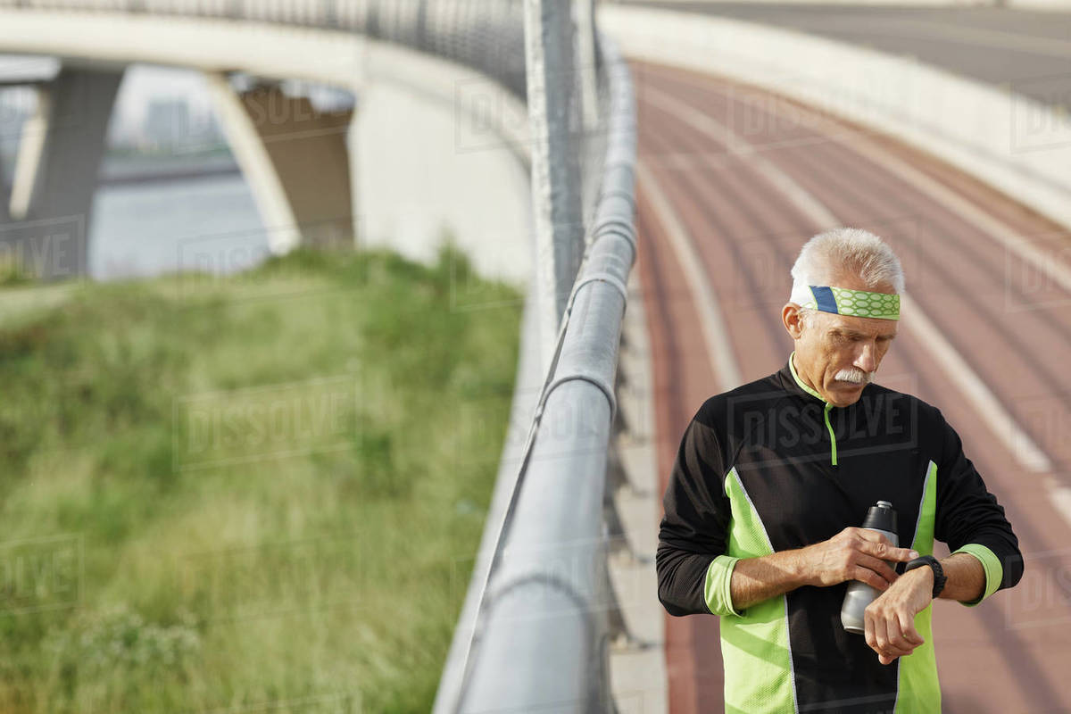 Sporty Aged Man Checking Time Royalty-free stock photo