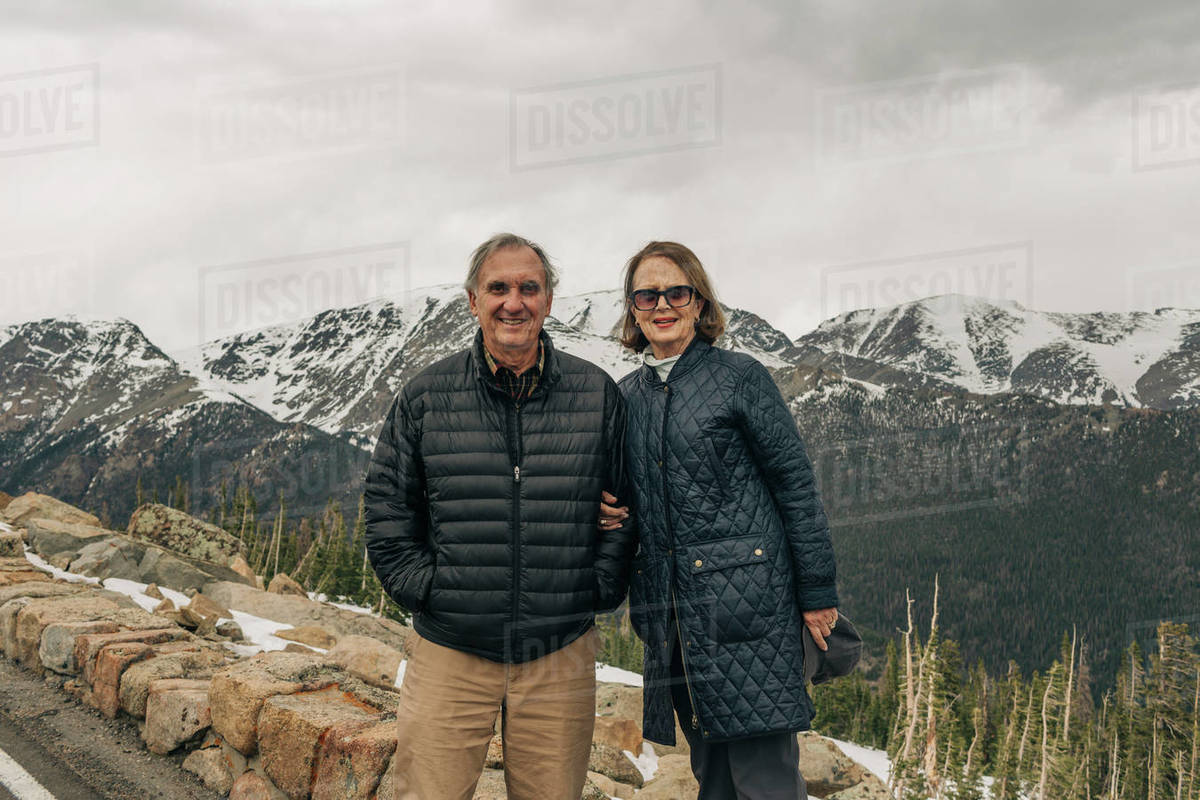 An older couple stands in Rocky Mountain National Park, Colorado Royalty-free stock photo