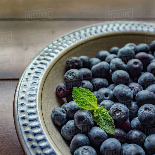 High angle view of blueberries on plate on wooden table Royalty-free stock photo
