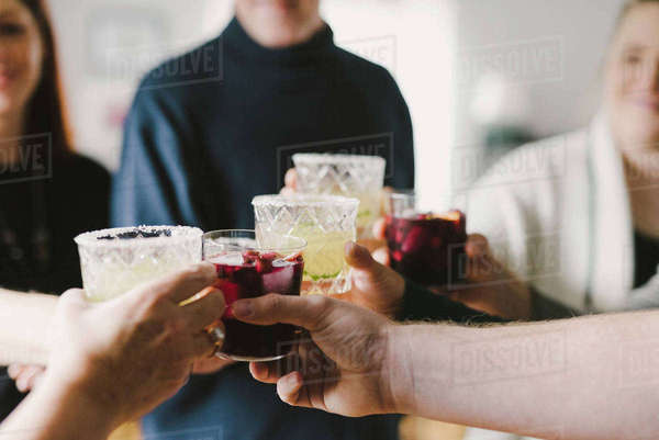 Happy friends toasting drinks in party at home Royalty-free stock photo