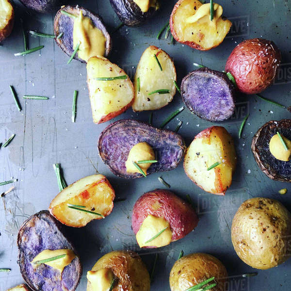 High angle view of roaster potatoes with rosemary on table Royalty-free stock photo