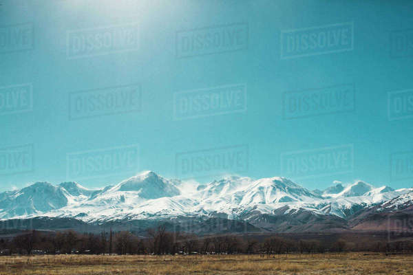 Scenic view of snowcapped mountains against clear blue sky during sunny day Royalty-free stock photo