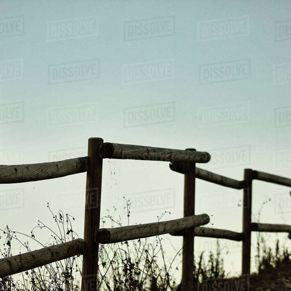 Wooden railing against clear sky during sunset Royalty-free stock photo