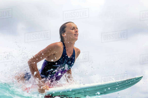 Woman surfboarding in sea against sky Royalty-free stock photo