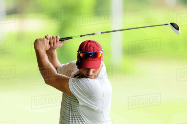 Close-up of man playing golf Royalty-free stock photo