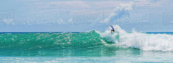 Panoramic view surfer surfing on huge sea waves against sky Royalty-free stock photo