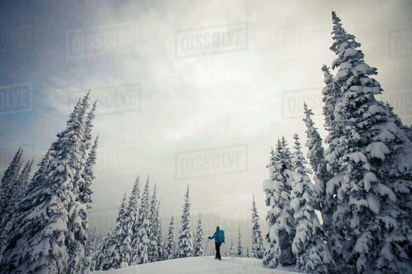 Side view of man standing on snow covered field against sky Royalty-free stock photo