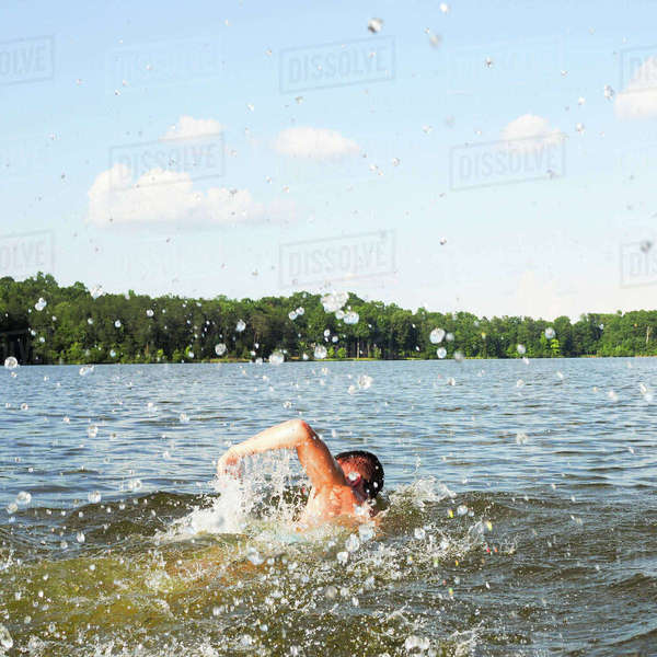 Rear view of man swimming in Lake Mackintosh against sky Royalty-free stock photo