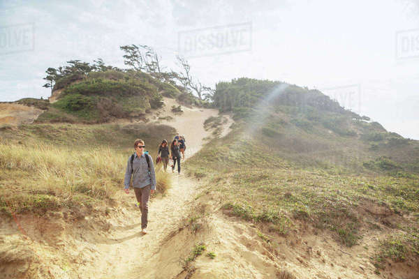 Friends walking on mountain against sky during summer Royalty-free stock photo