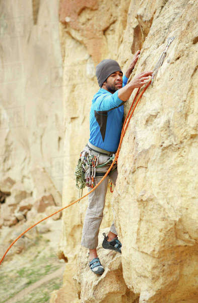 Determined man climbing rock Royalty-free stock photo