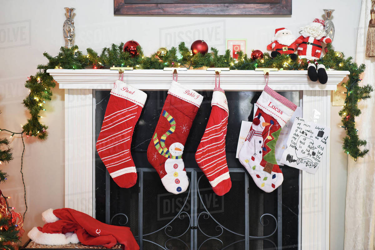 Christmas Stockings Hanging By Fireplace At Home Stock Photo