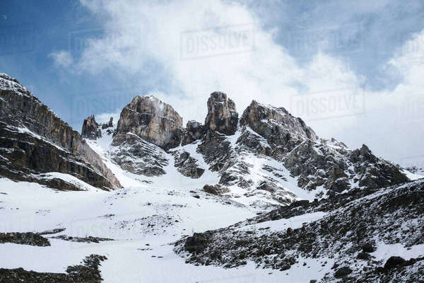 Scenic view of snowcapped mountain against cloudy sky Royalty-free stock photo