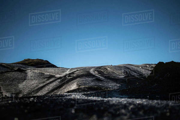 Dramatic landscape against clear blue sky Royalty-free stock photo