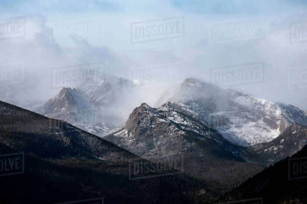 Scenic view of snowcapped mountain during foggy weather Royalty-free stock photo