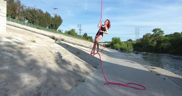Drone shot of a woman climbing on a rope Royalty-free stock video