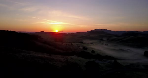 Drone shot of sunset over hills of Los Angeles Royalty-free stock video