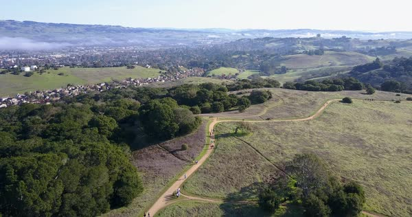 Drone shot of people hiking in hills of Petaluma Royalty-free stock video