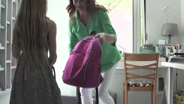 Mother getting daughter ready for school Royalty-free stock video