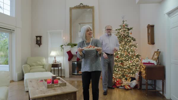 Medium shot of a senior woman giving cookies to her husband Royalty-free stock video