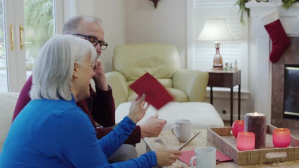 Medium shot of a senior couple opening a greeting card Royalty-free stock video