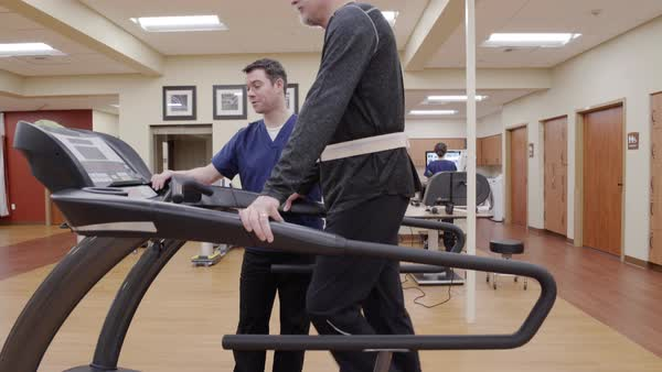 Medium shot of a senior man walking on a rehabilitation treadmill Royalty-free stock video