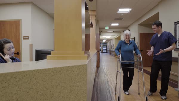 Medium shot of a senior woman using a walker Royalty-free stock video