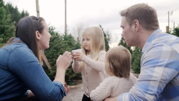 Medium shot of a little girl sharing a drink with her mother Royalty-free stock video