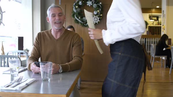 Mature man waiting in a restaurant Royalty-free stock video