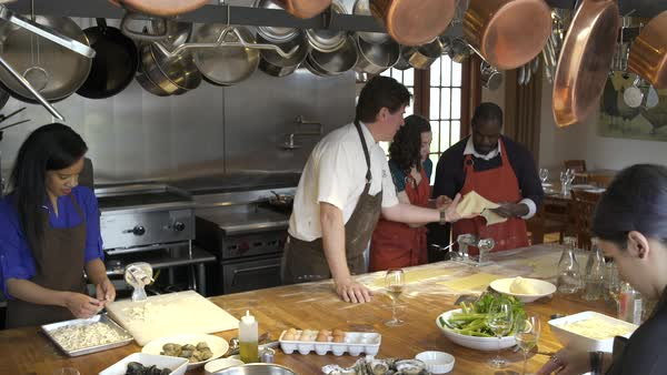 Chef teaching students how to work with pasta roller Royalty-free stock video