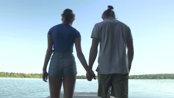 A young couple walking on a pier Royalty-free stock video