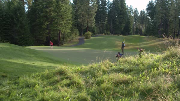 Three people playing golf on Suncadia Resort Royalty-free stock video