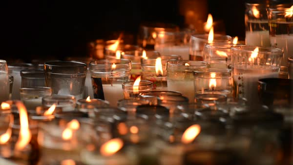 Hand-held shot of flickering candle lights Royalty-free stock video