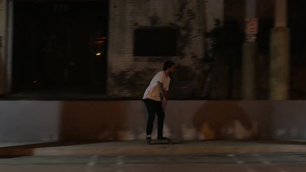 Tracking shot of a man skateboarding on a rundown street at night Royalty-free stock video