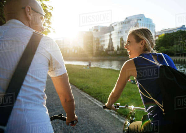 Germany, Berlin, Man and woman cycling in city Royalty-free stock photo